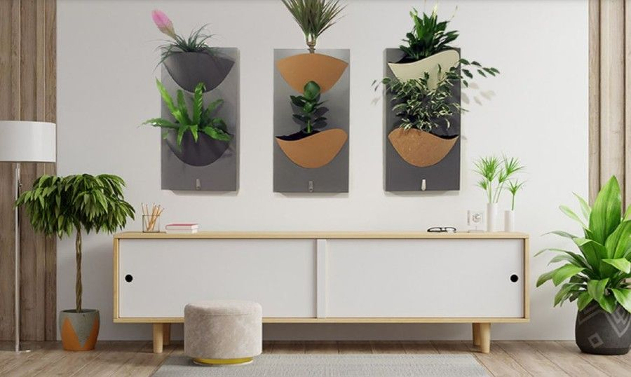 Biophilic meets IoT with the vertical plant wall display in this home.