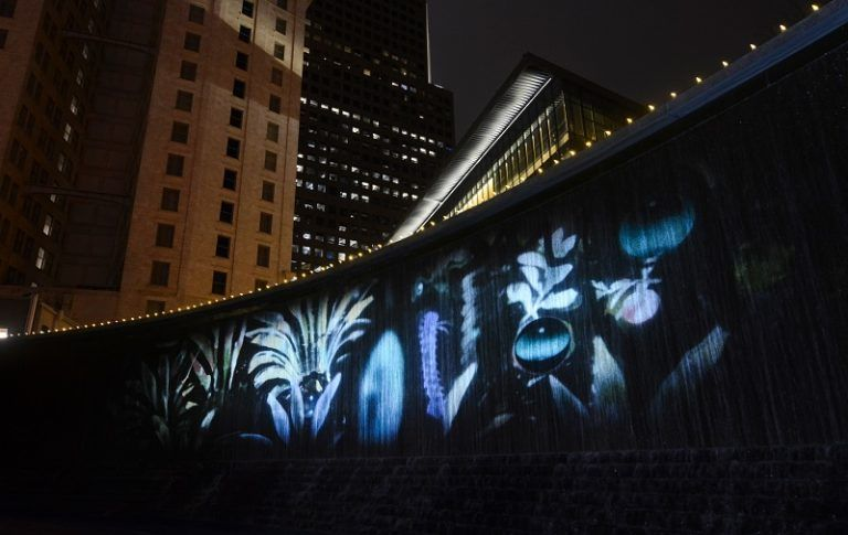 Flowing, biophilic projection display on waterfall in downtown Atlanta.