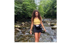 Sonos Wild Tracks curator Laura Edmonson in a river.