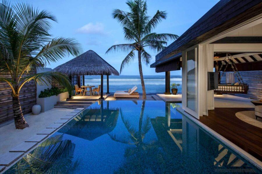 Pool patio at the Naladhu luxury island resort.