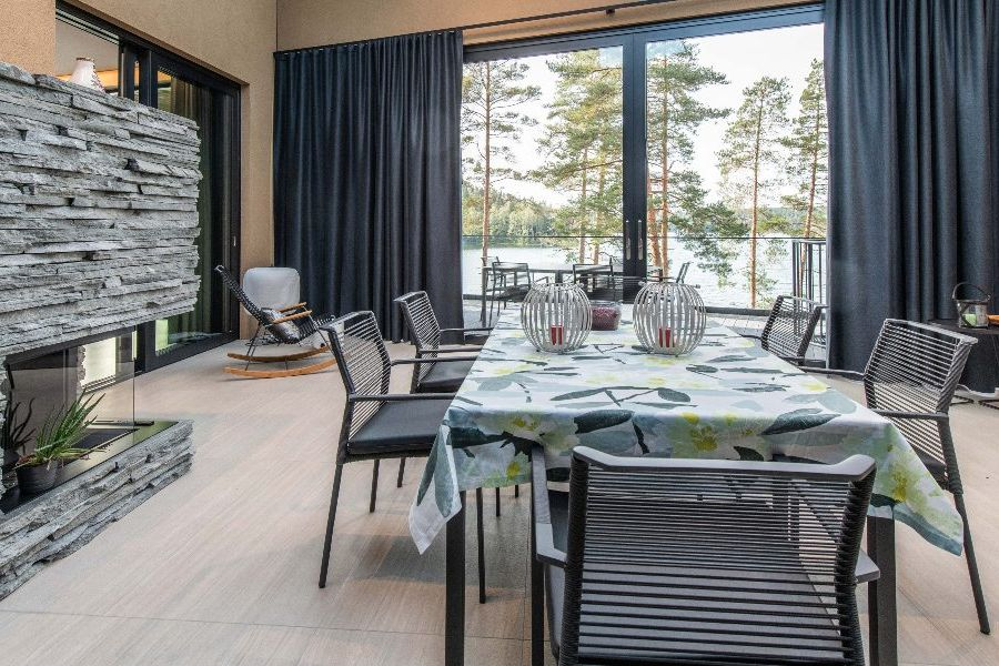 Interior fireplace and dining room within Finnish smart home.