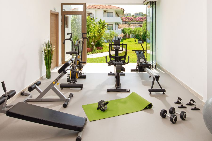 A home gym situated beside a folding glass wall, the focus of a recent Sonos study.