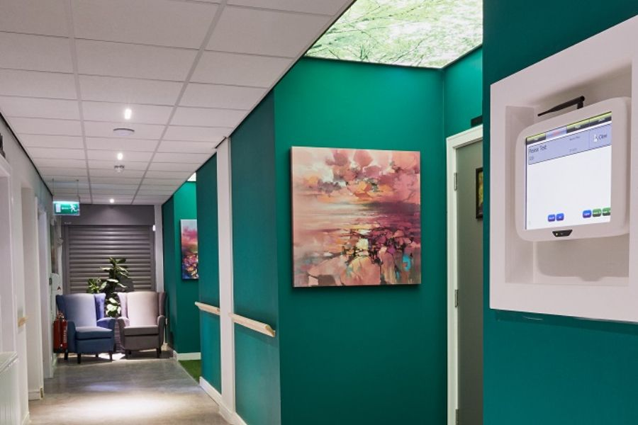 A wireless callbox set amidst artwork as part of the wellness technologies on display in the building.