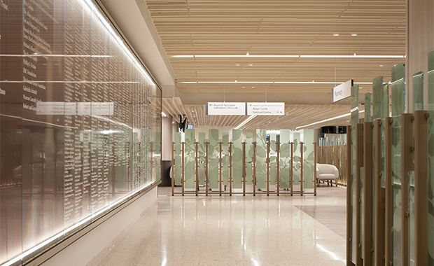 The wood-slat ceiling and modern terrazzo flooring as a part of the hospital's evidence-based design.